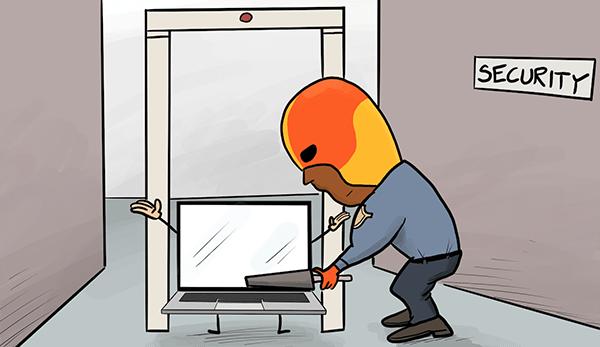 Image du Defender prenant un ordinateur portable dans un scanner d'aéroport.